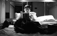 Steve Miller relaxes by reading in his private coach one hour before his sold out concert at the Mud Island Amphitheatre in Memphis, Tennessee on August 8, 1994. (David Woo/The Dallas Morning News)