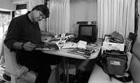 Steve Miller sorts through his mail on his private coach in St. Louis, Missouri before his sold out concert. (David Woo/The Dallas Morning News)