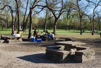 The Stone Tables, which were built by the city of Dallas in 1931, are a popular picnic spot for families. On any given weekend, the tables and adjacent playground are full of people.(Ananda Boardman - neighborsgo staff)