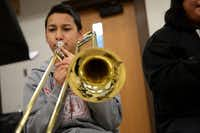 Eighth-grader Bryan Flores plays the trombone during his advanced band class. Prior to band director Wesley Walker's tenure, the music classes focused mostly on teaching students to play the recorder.( ROSE BACA/neighborsgo staff photographer )
