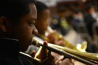 Seventh-grader Christopher Strong is a member of the advanced band class at Dallas ISD's Boude Storey Middle School.( ROSE BACA/neighborsgo staff photographer )