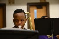 Seventh-grader Jaylen Bell plays the trombone. Boude Storey Middle School's band program now has more than 80 students.( ROSE BACA/neighborsgo staff photographer )