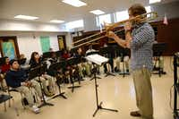 Walker gives a demonstration to his advanced band class during practice.( ROSE BACA/neighborsgo staff photographer )