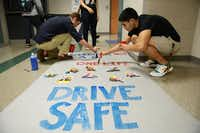 Chase Darden (left) and Jacob Ruse paint a poster during Suzanne Reese's leadership class, which includes senior members of the student council.( Photos by Rose Baca  - neighborsgo staff photographer)