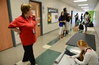 Reese supervises students during class.Rose Baca - neighborsgo staff photographer