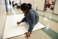 Sydney Franklin, Student Council president, works on a poster during Suzanne Reese's Leadership Class, which include senior members of the Student Council, at Creekview High School in Carrollton. The Student Council recently received the 2014 National Council of Excellence Award by the National Association of Student Councils. This marks the seventh year in a row the council has been honored with the recognition.( Rose Baca  -  neighborsgo staff photographer )