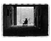 Bluegrass legend Bill Monroe was captured in silhouette, strumming his guitar in a barn in Last Winter, 1995.Marty Stuart