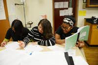 Eighth grade science students (from left) Jacqueline Aguilar, Dioscelina Chavez and Morgan Jackson work on a class assignment at Alex W. Spence Talented/Gifted Academy on Nov. 25. The academy is a Dallas ISD magnet that offers project-based pre-AP classes to prepare middle schoolers for high school.ROSE BACA