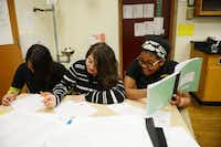 Eighth grade science students (from left) Jacqueline Aguilar, Dioscelina Chavez and Morgan Jackson work on a class assignment at Alex W. Spence Talented/Gifted Academy on Nov. 25. The academy is a Dallas ISD magnet that offers project-based pre-AP classes to prepare middle schoolers for high school.( ROSE BACA )