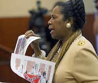 U.S. Rep. Sheila Jackson Lee, D-Houston, held up photographs while discussing a proposed Confederate battle flag license plate before the Department of Motor Vehicles Board in November 2011. The board ultimately rejected the proposed design, leading to a lawsuit from the Texas Division of the Sons of Confederate Veterans that is heading to a federal appeals court.(Ralph Barrera - AP)