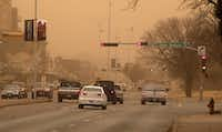 Cars navigate along University Avenue during a dust storm in Lubbock, Texas, Wednesday, Dec. 19, 2012.Zach Long - Journal