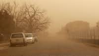Dust covers a residential area during a dust storm in Lubbock, Texas, Wednesday, Dec. 19, 2012.(Zach Long - Journal)