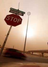 Cars navigate along the Marsha Sharp Freeway during a dust storm in Lubbock, Texas, Wednesday, Dec. 19, 2012.Zach Long - Journal