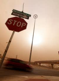 Cars navigate along the Marsha Sharp Freeway during a dust storm in Lubbock, Texas, Wednesday, Dec. 19, 2012.(Zach Long - Journal)