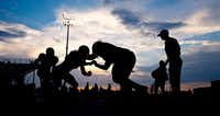 College Station High School football players warm up before a high school football game against Willis, Friday, Sept. 25, 2015, at Cougar Stadium in College Station, Texas. (Sam Craft/College Station Eagle via AP) MANDATORY CREDIT