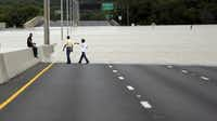 Flood waters cover eight lanes of Highway 281, Saturday, May 25, 2013, in San Antonio. The San Antonio International Airport by Saturday afternoon had recorded nearly 10 inches of rain since midnight.  (AP Photo/Eric Gay)Eric Gay - AP