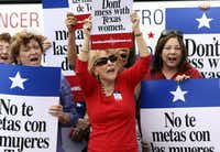 A rally in San Antonio last year protested the attempt to cut Planned Parenthood out of the state's Women's Health Program.