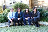 Unable to complete college herself, Martha Gonzales, second from left, was determined to see her three daughters attend, a dream that has come true for her and her husband, Aaron M. Gonzales. Daughter Karen (third from left) is now attending the University of Texas at Austin; Kimberly (far right) now has her master's degree ; and middle daughter Kristine (not pictured) starts studying for hers this month.(Photo by RUTH HAESEMEYER)