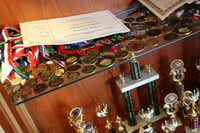 A case full of trophies, medals and other academic awards stands in the Gonzales' North Dallas home.Photo by RUTH HAESEMEYER