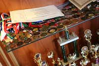 A case full of trophies, medals and other academic awards stands in the Gonzales' North Dallas home.( Photo by RUTH HAESEMEYER )