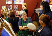 Center, from left: Helen Marshall, Adriana Hernandez and Janice Elliott of Cornea Associates of Texas try their hand at painting at Pinot's Palette in Dallas.(Tom Fox - Staff Photographer)