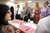 Trisha Weaver (left) got the plum job of judging the pie contest at the Uptown office of Republic Title of Texas. Workers are urged to play hard as well as work hard.(Tom Fox - Staff Photographer)