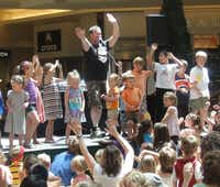 Summer Fun Thursdays at the Shops at Willow Bend in Plano begins June 13 and continues through July 25. Here Eddie Coker entertains the kids.