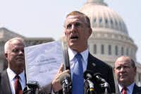 Rep. Tim Murphy, R-Pa., held up a copy of the Supreme Court's health care ruling during a news conference by the GOP Doctors Caucus on Capitol Hill in Washington. The Supreme Court caught many by surprise when it backed the Obama administration's health care reform in June 2012.