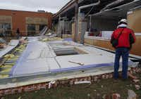 "Storm damage to Donald T. Shields Elementary school, (part of Red Oak ISD), shown Dec. 28 in Glenn Heights after tornadoes tore across North Texas two days earlier. Timothy P. Marshall (not pictured) is a consultant who focuses on wind damage and construction defect evaluations, among other things. He is participating in a damage survey team with the National Weather Service. As he surveyed the damage at Donald T. Shields Elementary in Glenn Heights, he posted this to his Facebook account: ""one of several walls that fell outward at this school. Walls were not attached to the steel frame and only had small nails to secure them into the concrete foundation. Thus, walls were in essence free-standing.""( Photo submitted by TIMOTHY MARSHALL )"