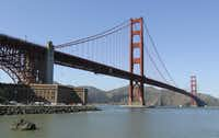 "In this photo taken March 9, 2012 the Golden Gate Bridge is shown at Fort Point in San Francisco. It served as a picturesque backdrop for Jimmy Stewart and Kim Novak's tensely romantic first meeting in ""Vertigo"" in 1958, made the cover of Rolling Stone in the '70s and was nearly decimated by a falling Romulan drill-of-death in 2009's ""Star Trek."" One way or another, the Golden Gate Bridge has packed a lot of history into its 75-year span. (AP Photo/Eric Risberg)"