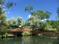 The 70-acre Sunrise Springs Integrative Wellness Resort is a refuge with cottonwoods and spring-fed ponds in the high desert of northern New Mexico.(Sunrise Springs Integrative Wellness Resort - Sunrise Springs Integrative Well)