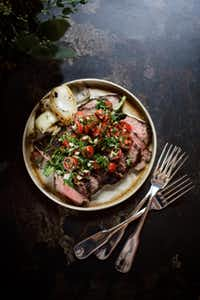 At Supper in the Hotel Emma, chef John Brand satisfies palates with dishes like grilled beef Santa Maria with tomato-parsley-garlic chimichurri.(Jody Horton - Jody Horton)