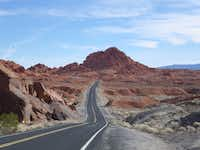 A two lane highway in Nevada's valley of Fire. A drive along this two lane highway cutting through Nevada's Valley of Fire provides views of some of the park's nicest rock formations and desert landscapes.
