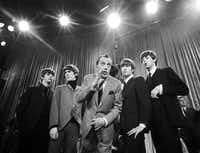 Ed Sullivan, center, stands with The Beatles, from left, Ringo Starr, George Harrison, John Lennon, and Paul McCartney, during a rehearsal.