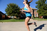 Ariana Luterman  runs down the street of her North Dallas neighborhood.(ROSE BACA)