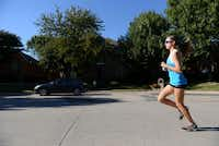 Ariana Luterman, 13, runs down the street of her North Dallas neighborhood. Luterman formed a brand, Team Ariana, to benefit homeless children in the Dallas area through her triathlons and will receive the Association of Fundraising Professionals' Outstanding Youth in Philanthropy award.( ROSE BACA )