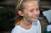 """TeamConnor junior advisory boardmember Caitlyn Coker sports a """"Connor the Caterpillar"""" tattoo during last year's Prayer Vigil at Watters Creek in Allen."""