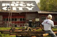 """See Rock City"" is the command atop an old barn off of Highway 27 near LaFayette, Ga. Painted barns and billboards have been the primary means of advertising."