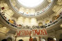 Abortion rights supporters rallied on the floor of the state Capitol in Austin in July. They said the law was designed to deny access and ignore medical advances.