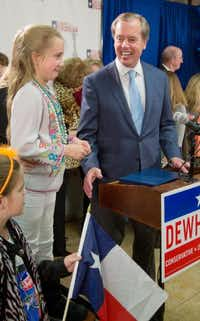 """David Dewhurst, with daughter Carolyn, expressed confidence. """"We are living in the middle of a Texas miracle and, together, we'll keep it going,"""" he said.Richard Carson - The Associated Press"""