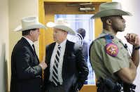"Jackson County Sheriff A.J. ""Andy"" Louderback (left) talks with Chambers County Sheriff Brian Hawthorne before testifying at a Senate hearing on campus carry and open carry legislation.(Eric Gay - The Associated Press)"