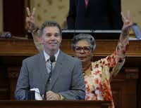 """People still think we're raiding the piggy bank,"" said El Paso Democratic Rep. Joe Pickett, deflecting GOP fears that the constitutional amendment he co-wrote would deplete the rainy day fund. Behind him, Rep. Senfronia Thompson, D-Houston, signals a ""no"" vote."