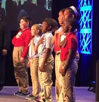 Students from Thomas Haley Elementary recite the Pledge of Allegiance at the Irving CVB Hospitality Industry Annual Meeting.