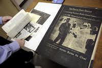 A film negative copy of a Dallas Times Herald is shown at the Poage Library.