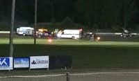 Ambulances arrived at Canandaigua Motorsports Park in New York Saturday after the track was shut down following the collision that killed Kevin Ward Jr. Investigators are trying to reconstruct events leading to the fatality, asking spectators to turn over video and photos of the crash.( Logan Messerly  - AP)