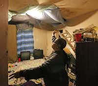 "The Bonner family has used Sheetrock and bedsheets in attempts to cover holes in a bedroom ceiling. ""I'm afraid one of these days I'm going to be lying in bed and everything is going to cave in on me,"" she said.( Louis DeLuca  -  Staff Photographer )"