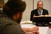 Rabbi Yaakov Rich speaks to a study group at Congregation Toras Chaim in Far North Dallas. The congregation, which holds prayer services and study groups at the home throughout the week, is being sued by neighbor David Schneider, who says the home is in violation of deed restrictions that limit the homes for residential use only.Rose Baca