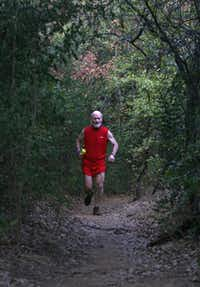 Cliff Kosec, 64, of Euless runs along a dirt trail that's part of the Grapevine Lake trail system.
