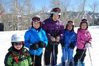 This February 2013 photo provided by the 70 + Ski Club shows Dee Wang, 89, of Shelburne, Vt., skiing with her great-grandchildren in Park City, Utah. The National Ski Areas Association says the number of seniors on the slopes has been creeping up each year while other age groups hold steady or decline.