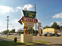 The Desert Hills Motel on Route 66 exhibits the road's nostalgic appeal with funky signs and old-school architecture. Some sections of the road evoke the 1950s with a trendy vibe, others are on the seedy side.(Beth J. Harpaz - The Associated Press)